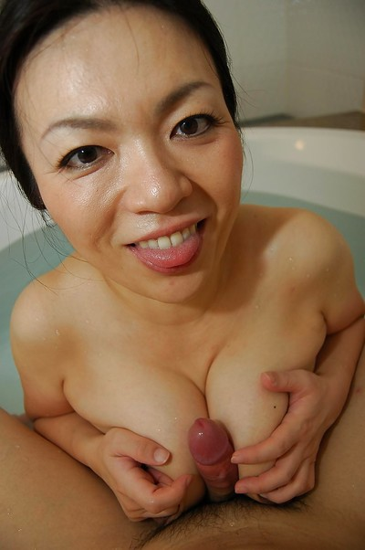 Saucy eastern MILF gives a physical tit and oral play in the bathroom