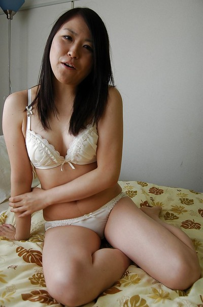 Lusty Japanese lass striptease and swelling her furry vagina lips in close up