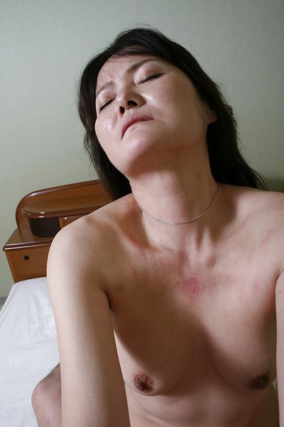 Raunchy Japanese MILF Michiko Sudo benefits from owned and facialized