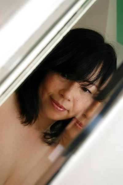 Japanese MILF Norie Shibamura undressing and widening her wavy lower than lips