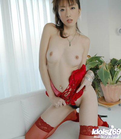 Seductive oriental hottie with miniscule apples posing in red sexy pants and nylons