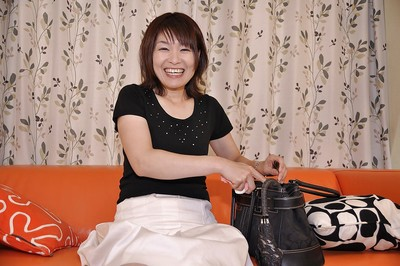Smiley Japanese MILF Miki Ando lifts up her petticoat and vibes her g-point