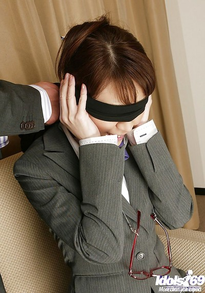 Blindfolded Japanese lady in nylons accepts her love-cage pressed with dildos