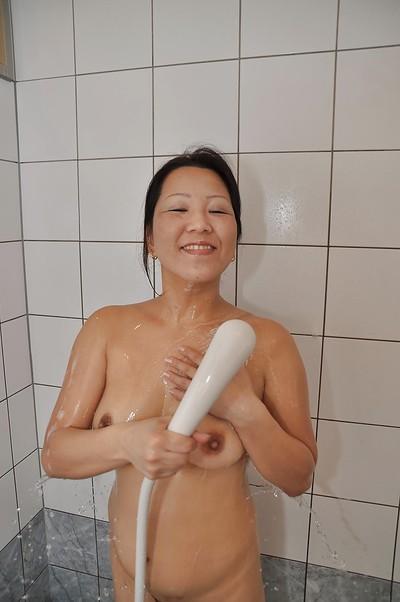 Oriental MILF with hirsute cooter and shapely zeppelins Kumiko Katsura voluptuous bathroom