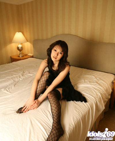 Marvelous Japanese young in openwork nylons takes off her suit and underclothing