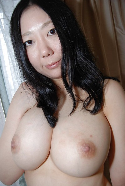 Well-stacked Chinese lassie undressing and exposing her moist cum-hole in close up