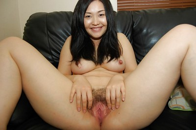 Smiley Chinese amateur discloses her hirsute gash and has some vibing satisfaction