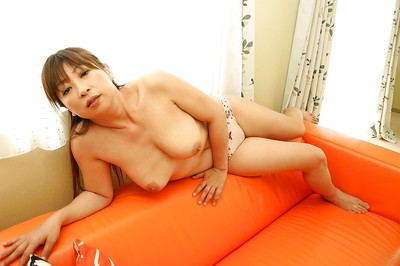 Eastern ripe lady Nozomi Oshima undressing and exposing her vagina in close up