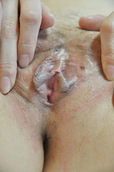 Shy eastern MILF with joyous front bumpers undressing and exposing her drenched muff