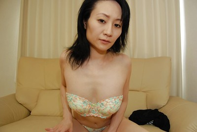 Shy eastern MILF with miniscule bazookas striptease down and vibing her unshaved snatch
