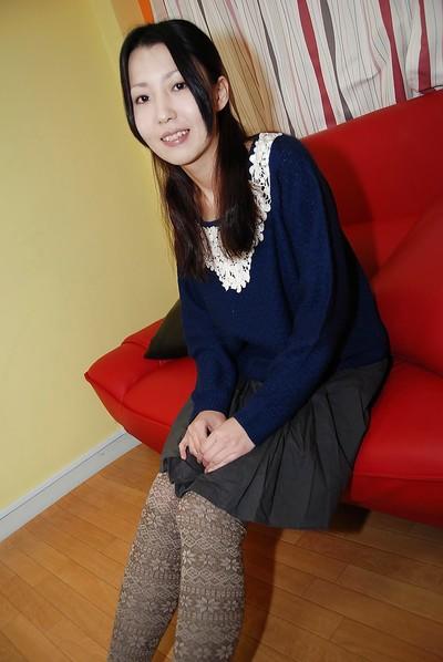 Brunette hair Eastern chicito Yui Nakazato demonstrates her small milk shakes