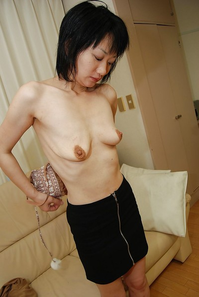 Shy oriental MILF undresses down and obtains her bald gentile filled with a tool