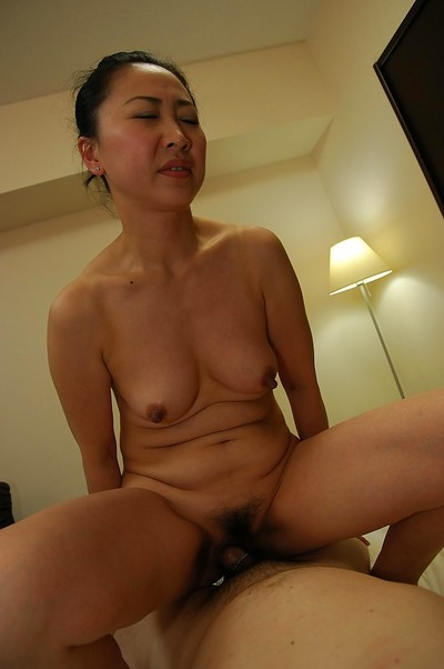 Oriental MILF Naoko Yamaguchi accepts drilled and takes a  on her chin