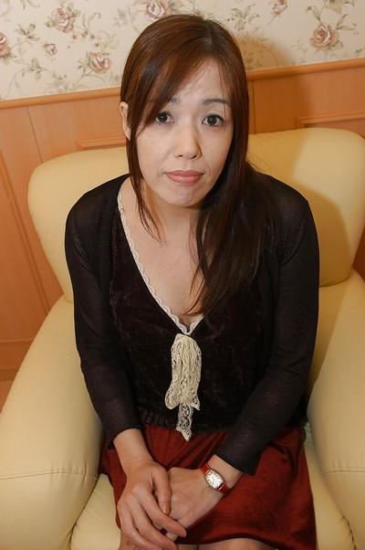 Oriental MILF with wavy gash Eiko Sakai undressing and amplifying her legs