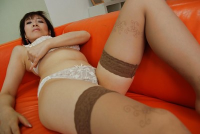 Chinese MILF Shinobu Yabe undressing and exposing her twat in close up