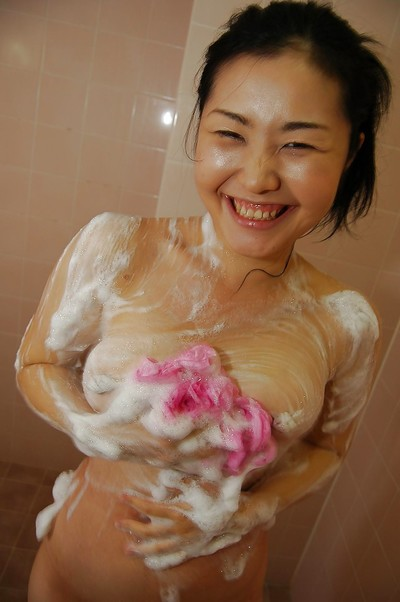 Appealing Chinese amateur pleasing baths and exposing her soapy goods