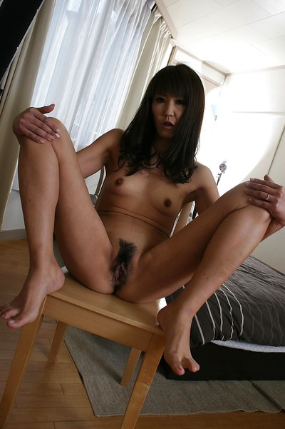 Slippy Japanese lady Emiko Okajima erotic dance down and amplifying her legs