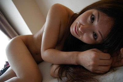 Japanese hottie Risa Yamane posing stripped and showcasing her pink pussy in close up