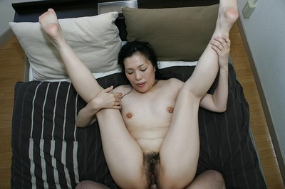 Japanese model Mari Inui gains her vagina delighted with a tight penis and a phallus exchanger