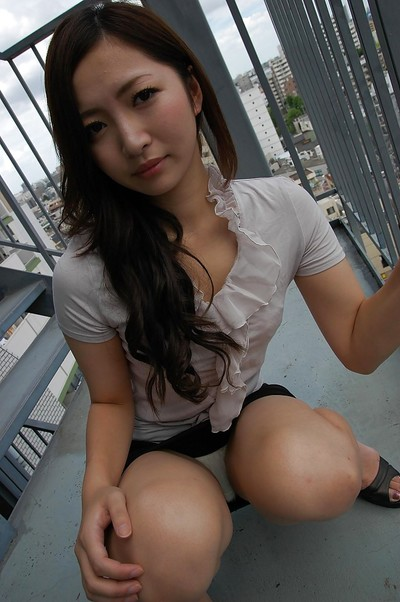 Eastern youthful Yuma Yoneyama undressing and expanding her underside lips in close up