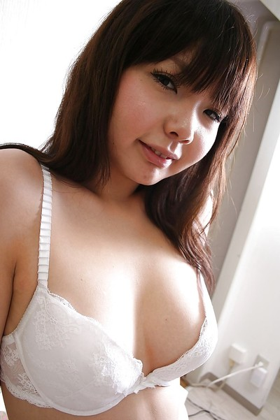 Corpulent oriental darling in underware and hose undressing and vibing her muff