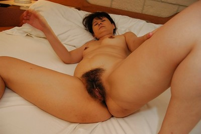 Shy Japanese MILF getting undressed and vibing her unshaven cooter