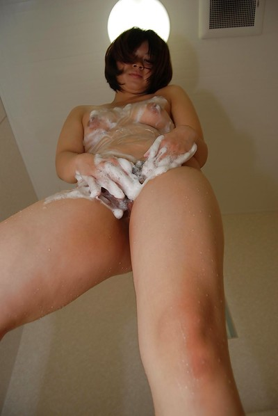 Oriental infant shows her wavy gentile and attains on her knees to take in a pecker