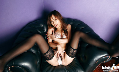 Boobsy oriental doll in nylons Yua Aida slipping off her underclothes