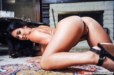 Hot dark hair pornstar Eva Lovia posing solo in her shorts