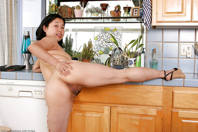 Juvenile Japanese hottie Tiny baring billibongs and jerking off in kitchen