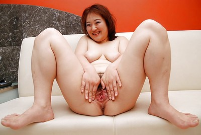 Fatty Chinese princess Keiko Etou undressing and showcasing her unshaven gash
