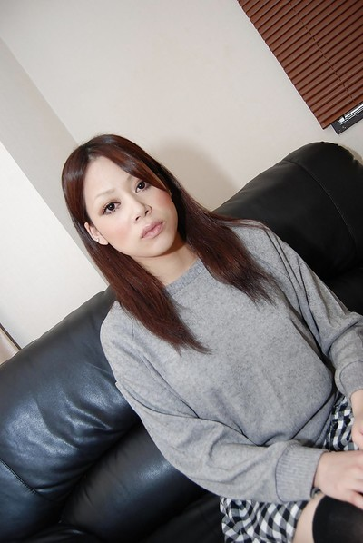 Covered Japanese Mayu Matsukawa demonstrating her wonderful anus on a sofa