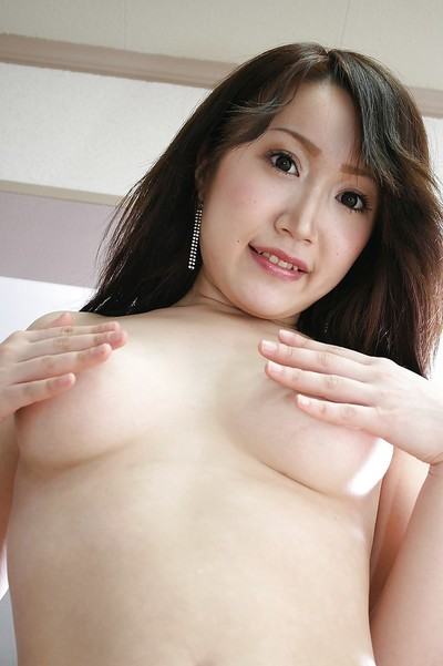 Alluring Japanese youthful Makoto Mukai undressing and expanding her bottom lips