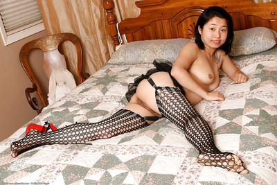 Infant Eastern queen Insignificant posing topless in extreme underware and garters