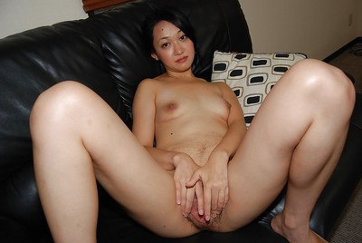 Shy Japanese queen removes clothes down and receives her bushy cage of love fingered