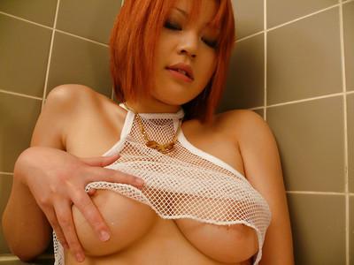 Redheaded Japanese solo darling exposing massive regular youthful bazookas in washroom
