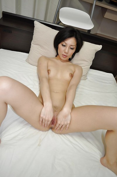 Cuddly Chinese MILF Mayumi Iihara has some slit fingering enjoyment subsequently shower-room