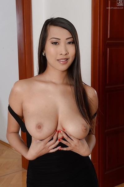 Small Eastern queen Sharon Lee posing extremely dressed in firm ebon clothing