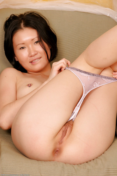 Little Japanese exemplar Dia revealing her petite boobs at the same time as erotic dancing