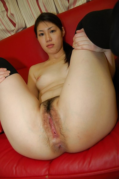 Pretty dark hair Japanese doxy Yui undressing her gazoo and body