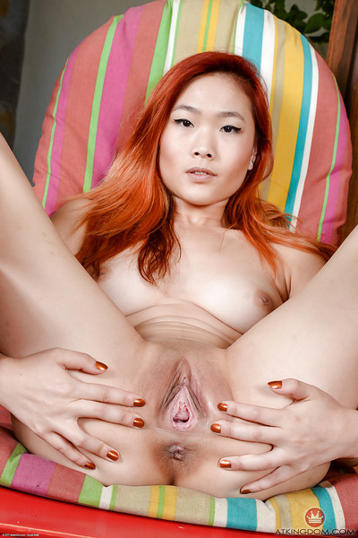 Redheaded Chinese youthful Lea Hart baring meaningful a-hole and bald love-cage