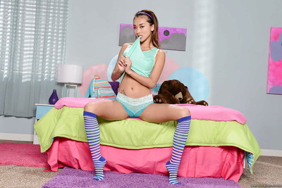 Alina Li is revealing her thin body in taut blue strings in her room
