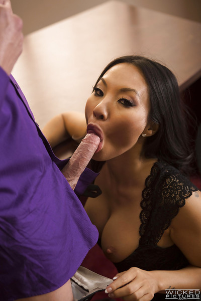 Japanese MILF pornstar Asa Akira giving covert knob a dick sucking on her knees