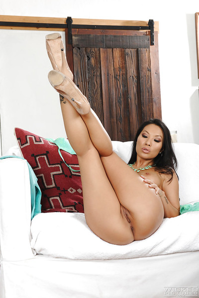 Appealing Asian hottie Asa Akira displaying sleek legs and fine scoops