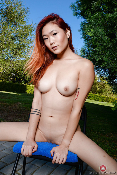 Redheaded Oriental juvenile Lea Hart exposing superior wazoo and slit outdoors