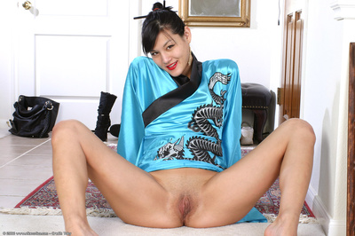 Teen Japanese doll in kimono amplifying her up till now smooth head cage of love