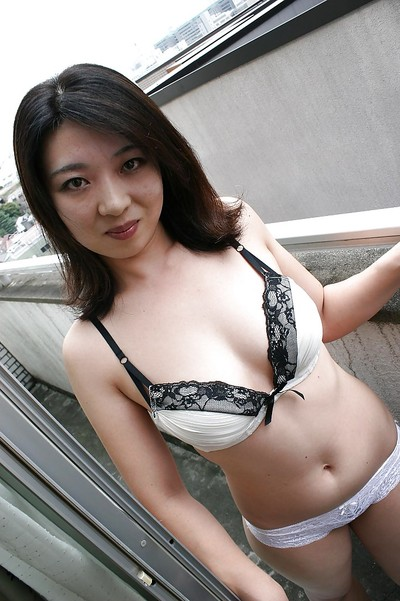 Oriental MILF Naho Tajiri grand off her underclothes and toying her shaggy gash