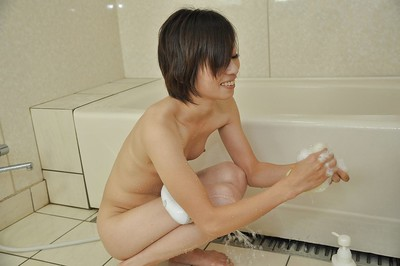 Svelte oriental MILF Chiaki Sugai takes shower-room and gives a soapy hand gig