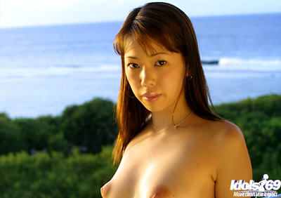 Gigantic titty Eastern angel Hikari removes clothes off sexy pants whilst outdoors