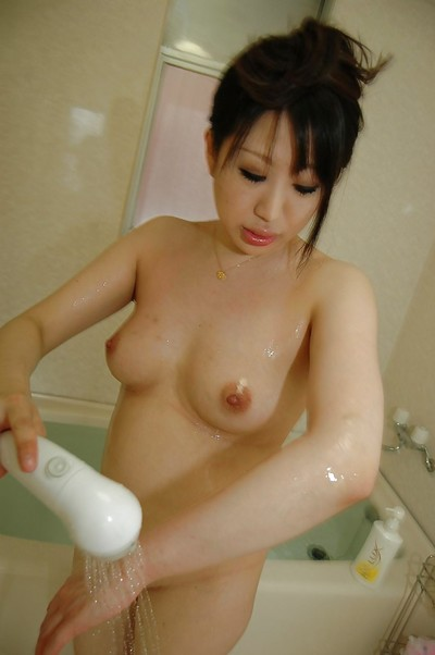 Heavy oriental MILF with vivacious love melons engaging bathroom and rubbing her soapy twists